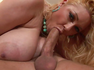 Busty babe gives a wet blowjob