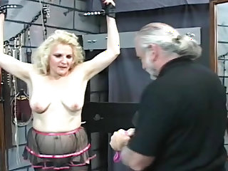 Chubby blonde milf spanked in his dungeon