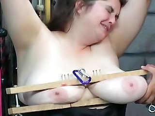 Fat BDSM slut in black corset
