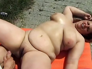 Fat redhead goes anal outdoors