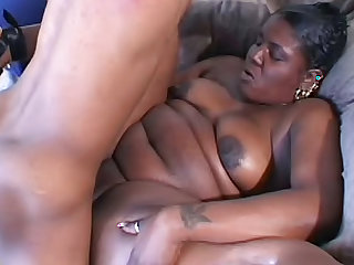 Big black girl in pink lingerie laid